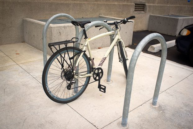 White bike locked to rack