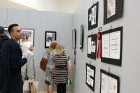 Visitors admire student artwork