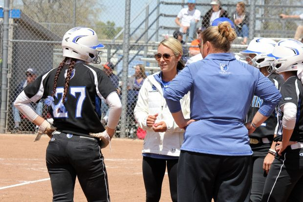 Tara Bendt, center, coaching Dani Perkins