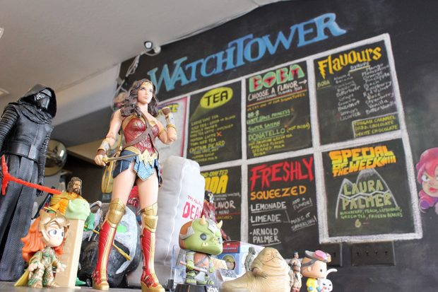 Action figures and toys in foreground, Watchtower menu in background