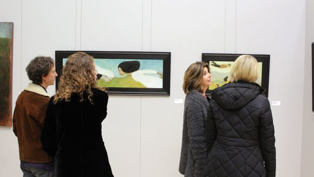 people admiring art pieces 1 Presidents art show 2018