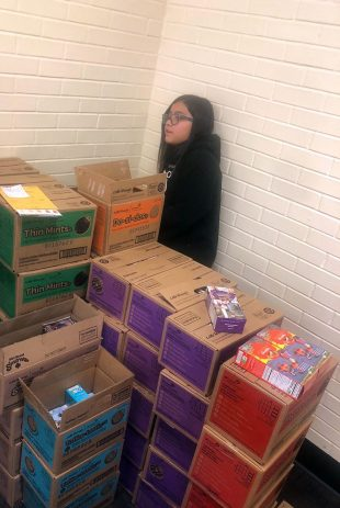 Melody Hernandez with her Girl Scout cookies