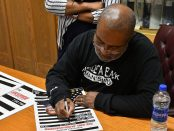 Ron Stallworth signs posters