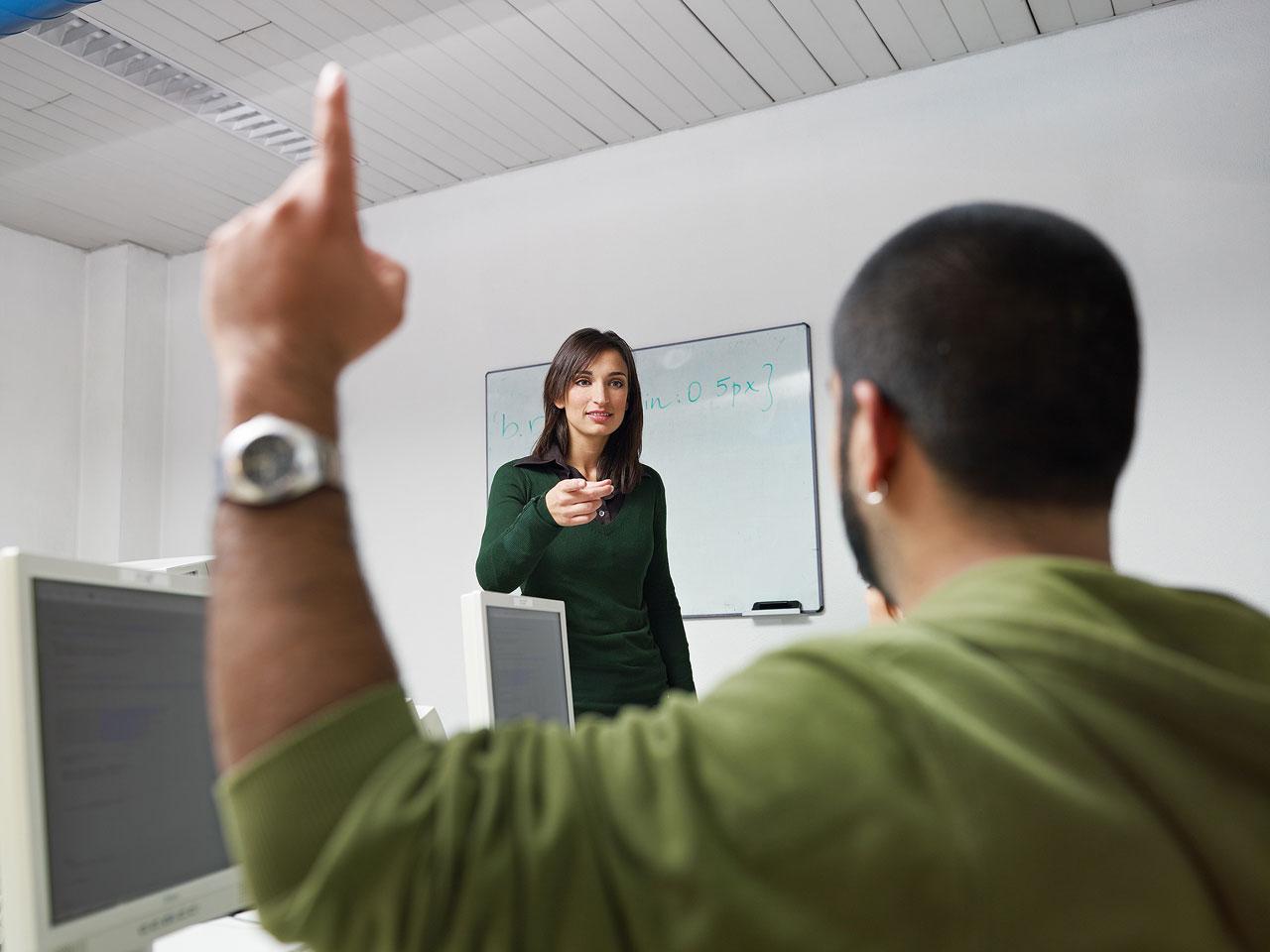 Hispanic student asking question to female teacher
