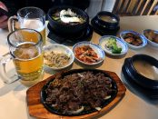 Myung Ga entrees with side dishes and Asahi beer