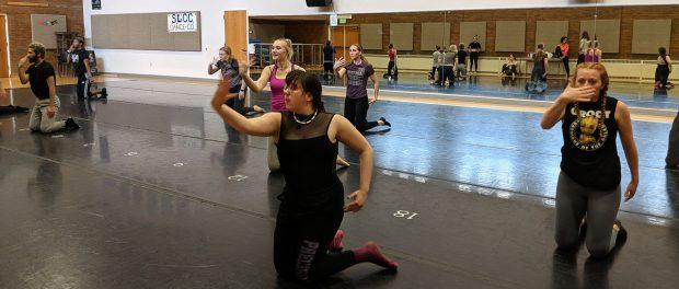 Dance Company members dancing on floor