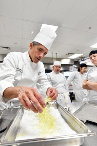 Franco Aloia prepares a dish
