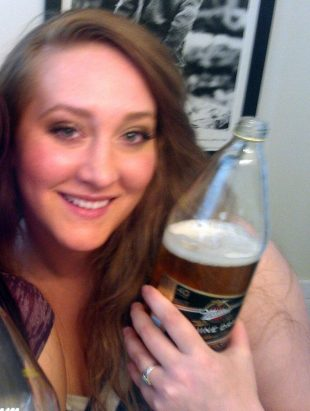 Shae Howell holding a beer