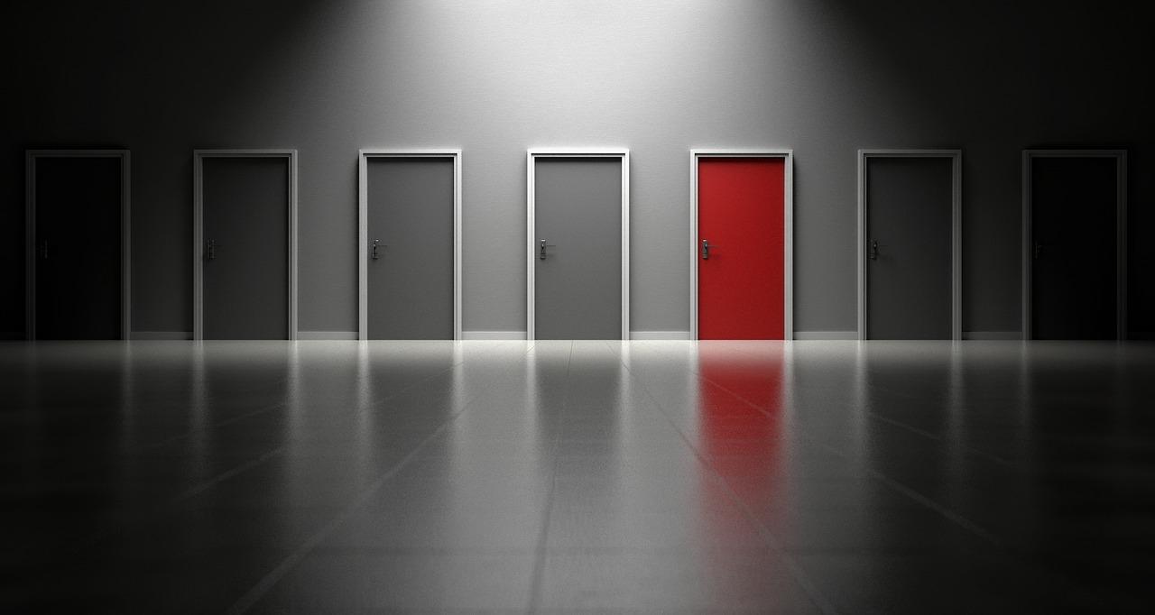 One red door among a row of gray doors