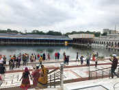 Visitors walk down to cleansing pool