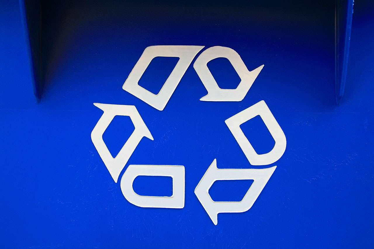 White recycling symbol on blue background