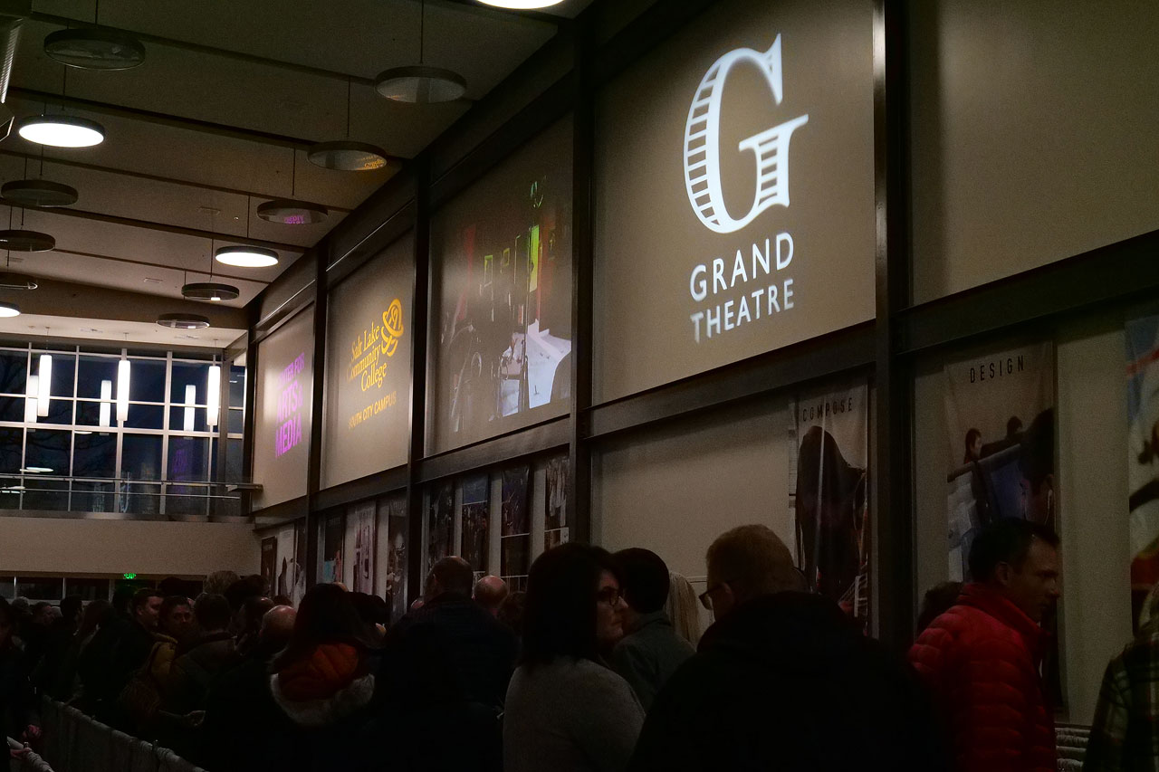 Crowd gathers outside Grand Theatre entrance