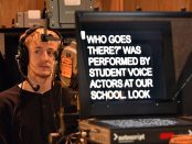Male student runs a camera behind a teleprompter