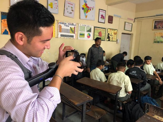 Noah takes pictures and video of students in the classroom