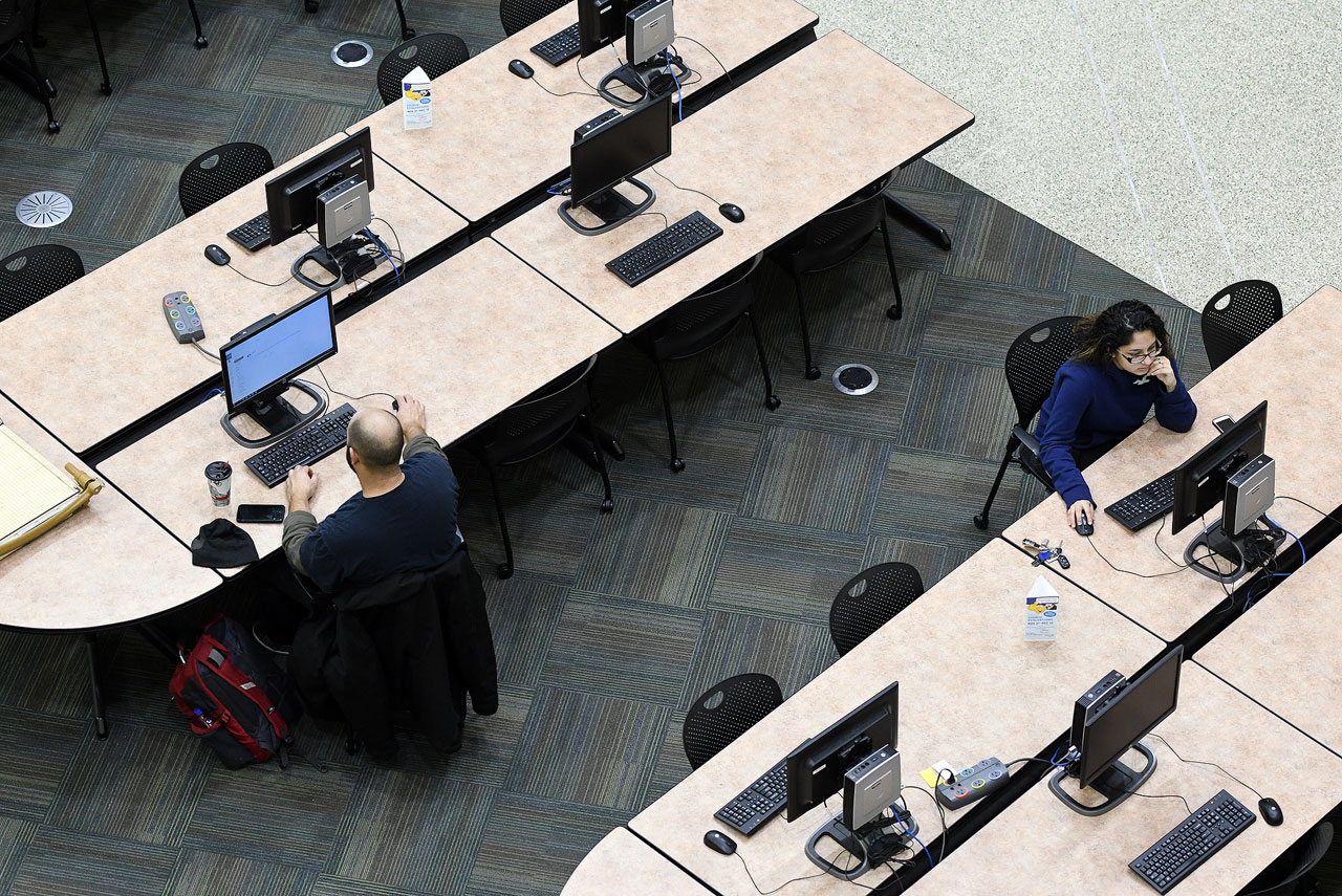 Male and female student use computers