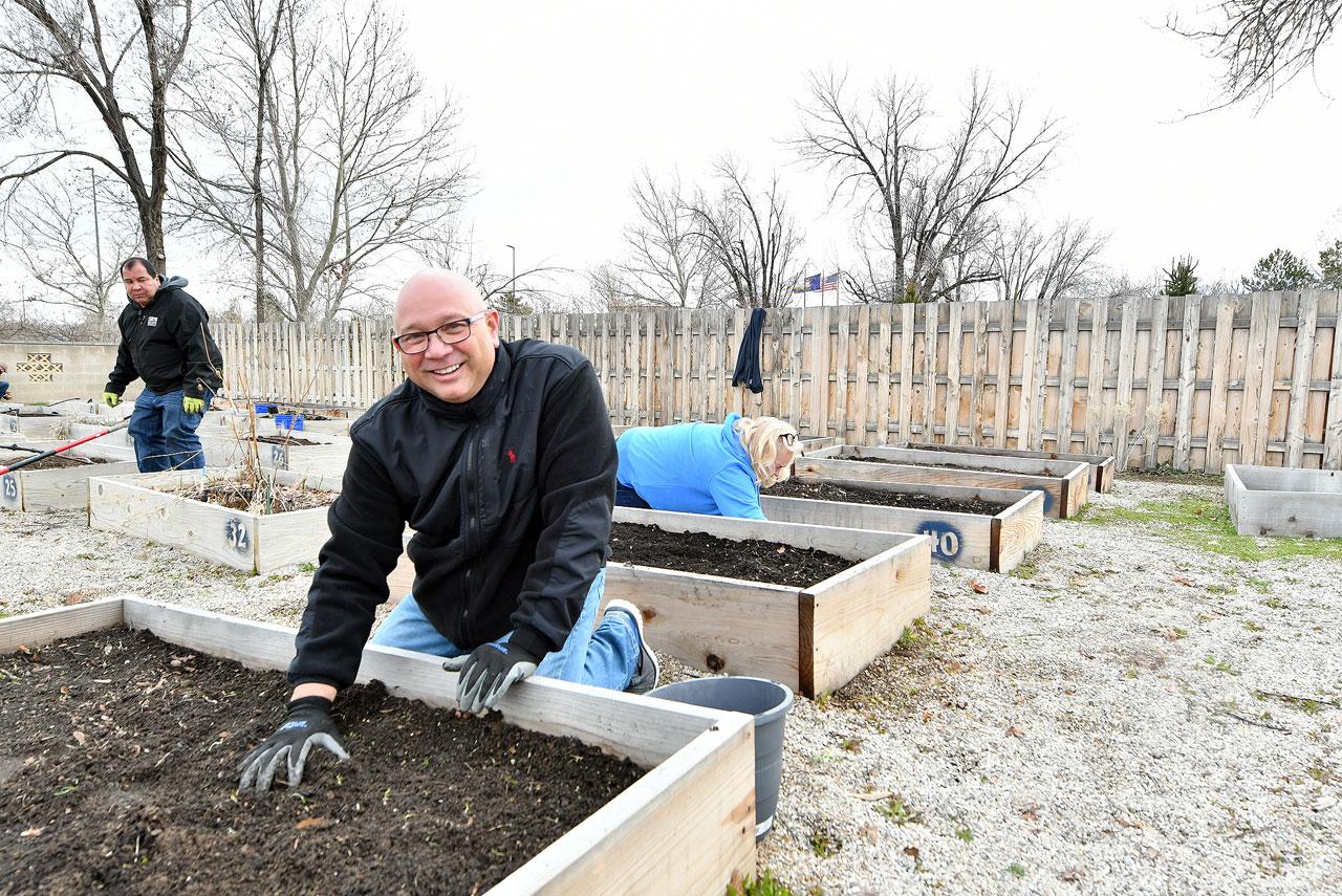 Dr. Lepper cleans up a garden box