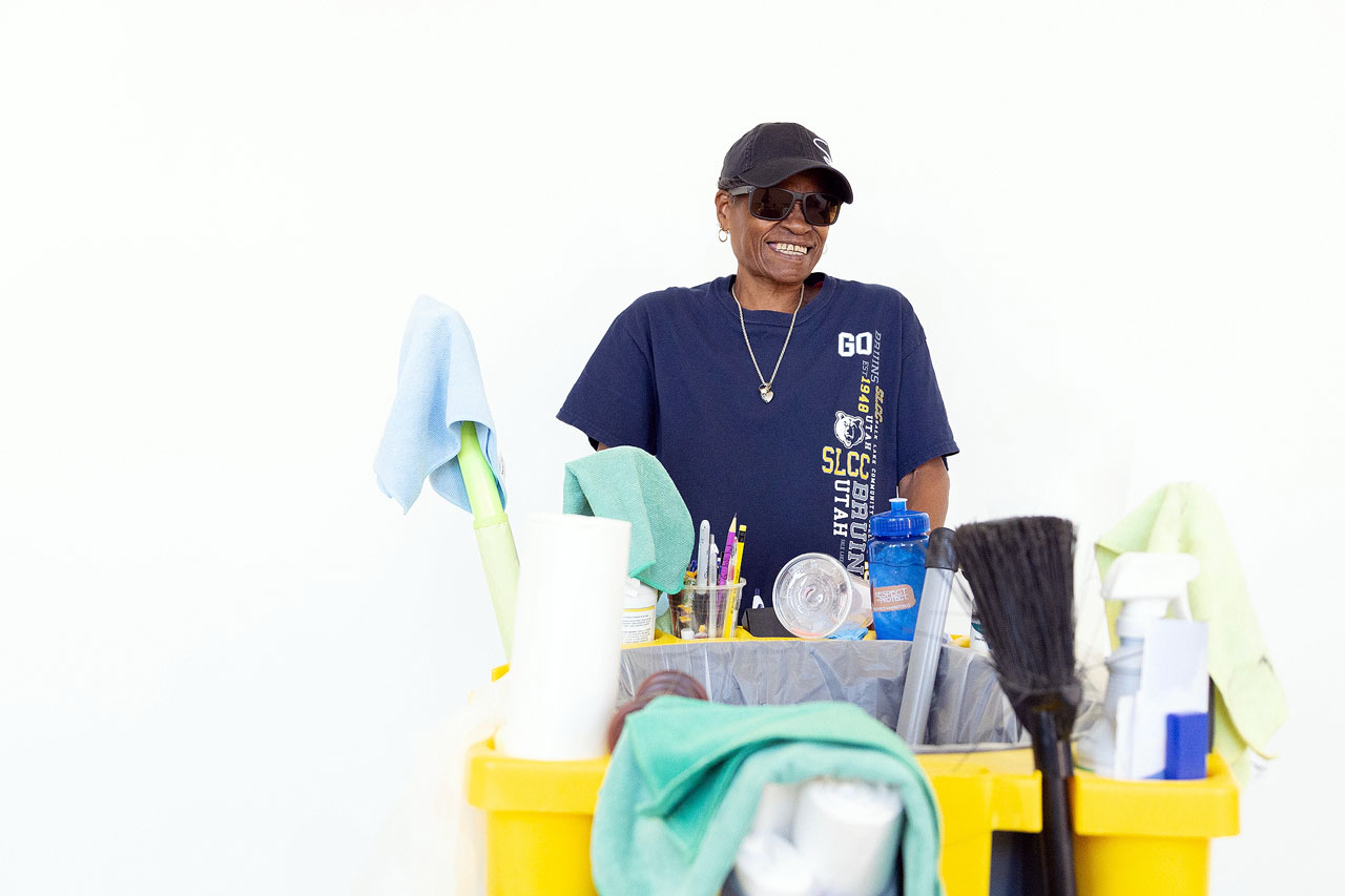 Sheri with her cleaning cart