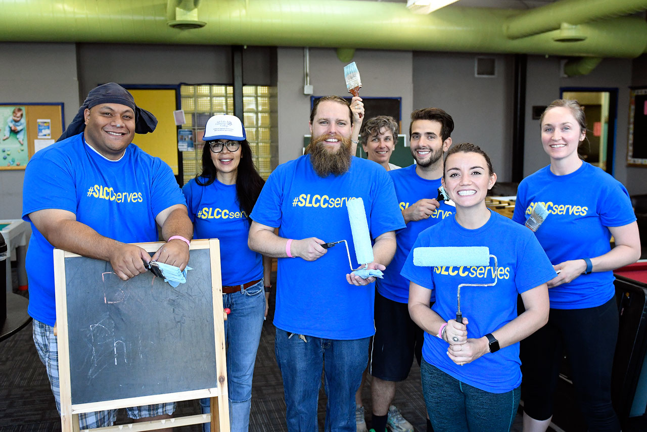#SLCCserves volunteers with paintbrushes