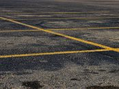 Parking lot painted with yellow lines