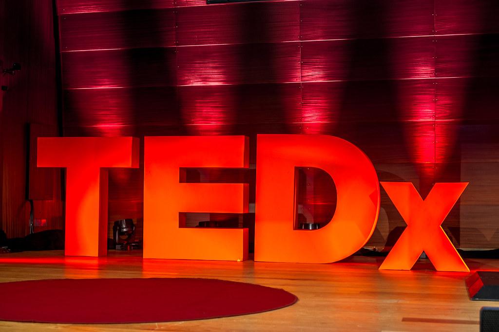 TEDx logo on stage