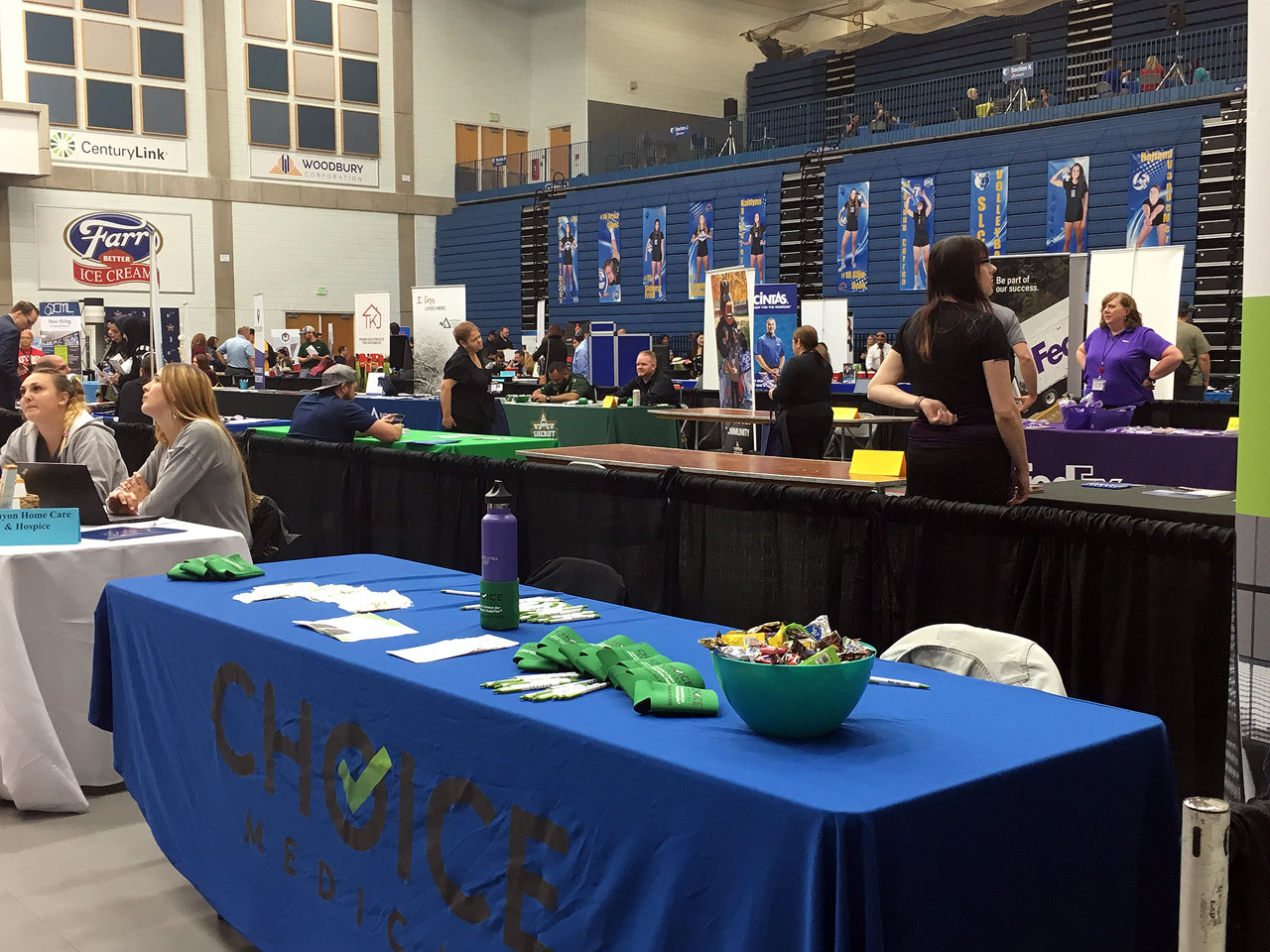 Tables and booths set up inside Lifetime Activities Center