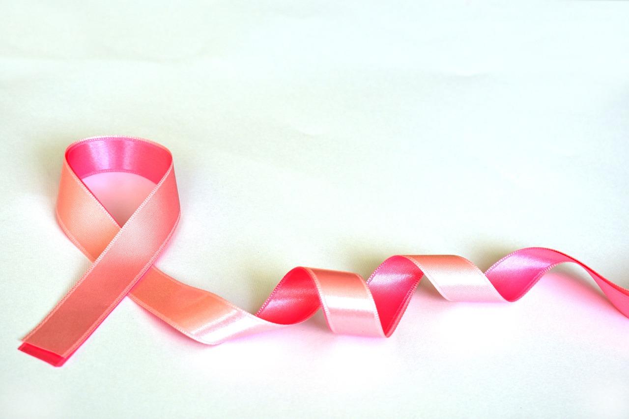 Pink ribbon on white background