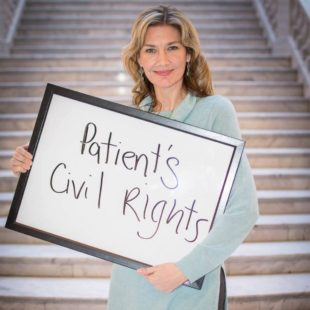 """Christine holds a sign that reads """"patient's civil rights"""""""