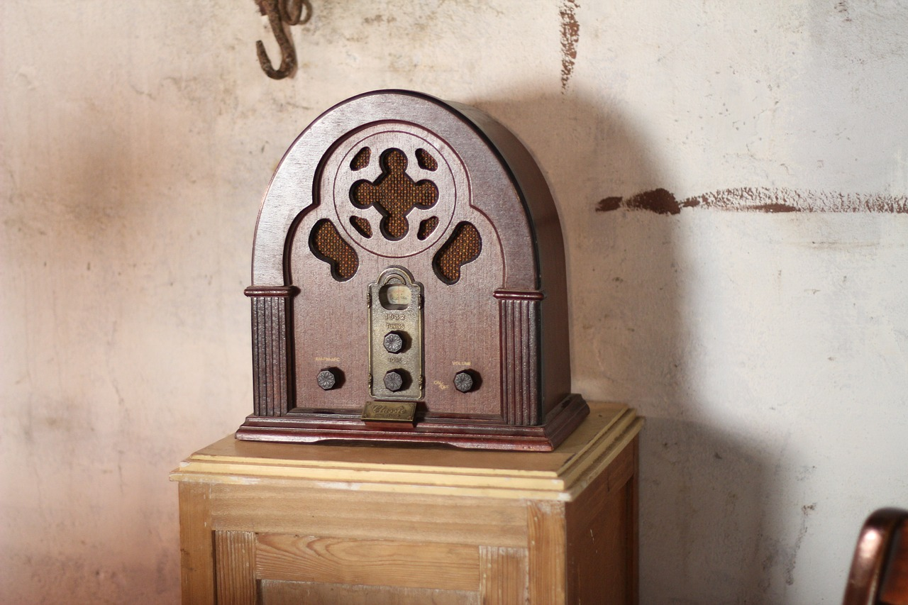 Old radio sitting on a small table