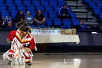 Native American dancer in red robe