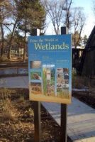 """Enter the World of Wetlands"" sign"