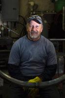 Portrait of Richard Prazen in his shop