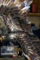 Metallic eagle sculpture
