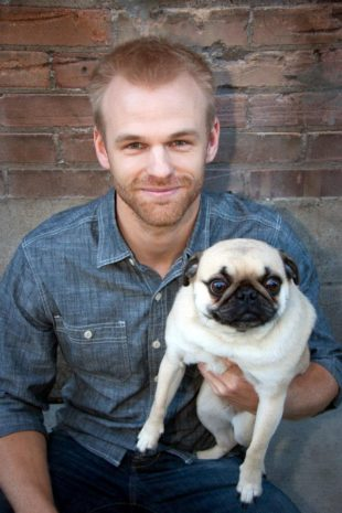 Ryan holding a pug