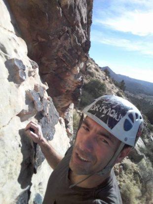Saul Gilbert takes a selfie while climbing