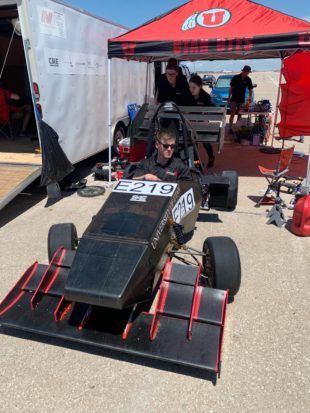 Kohl Schoensee in the driver's seat of electric car