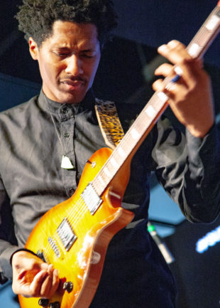 Ron Artis II plays guitar
