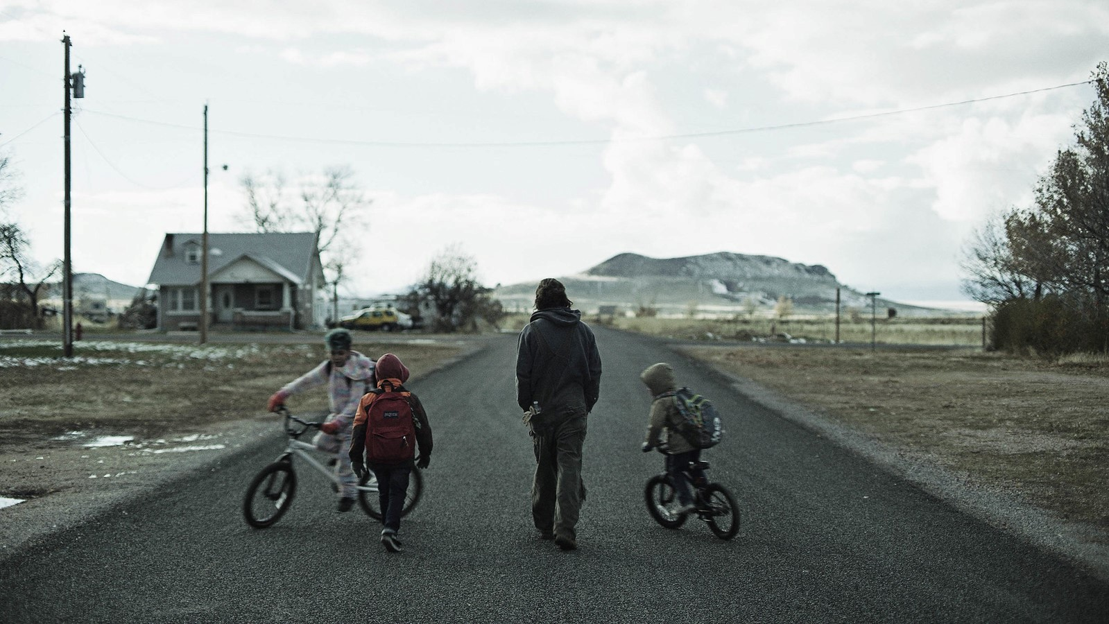 David walks with three of his children