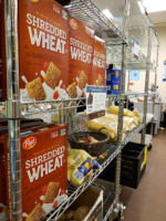 Pantry rack full of cereal, potatoes and noodles