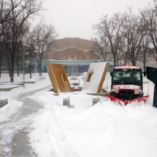 UTV plows snowy sidewalks