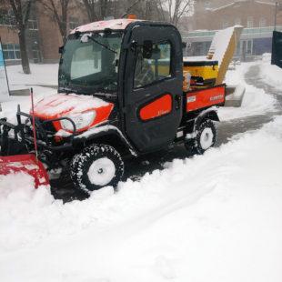Kubota RTV plows snow
