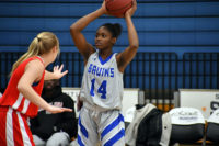 Aminata Diakite holds the ball over her head