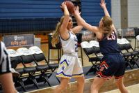 Kalee Philips holds the ball over her head
