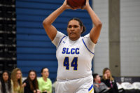 Leichan Williams holds the ball over her head