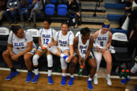 Bruin players rest on bench