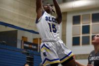 Awa Sidibe leaps over defender