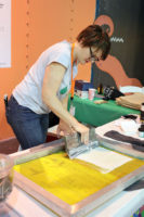 Amy Royer demonstrates screen printing