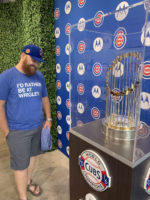 Brian admires World Series trophy behind glass