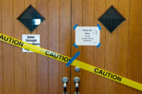 Caution tape restricts entry to Grand Theatre