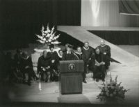 Graduating student speaks at podium