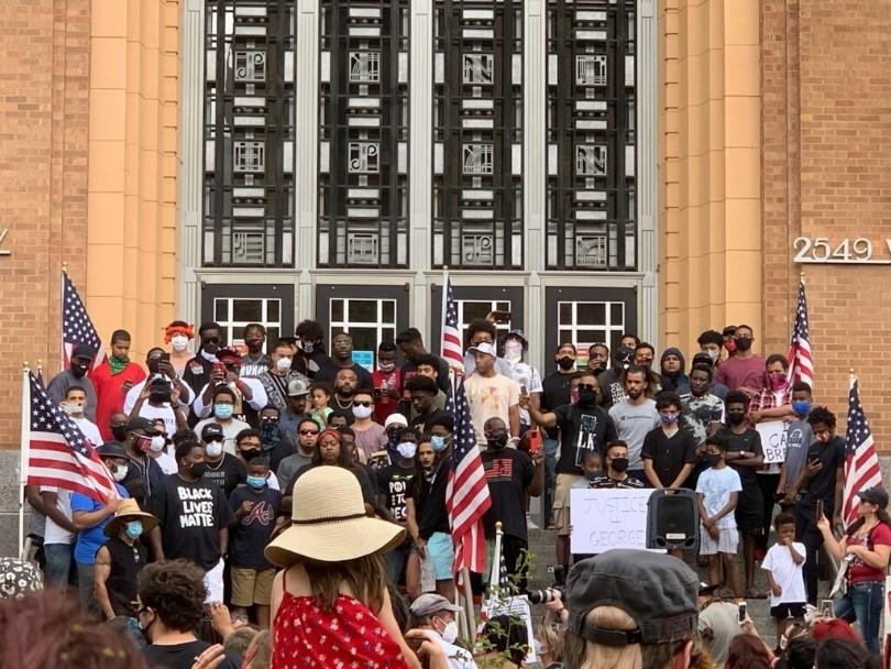 Black men stand together outside Ogden City Hall